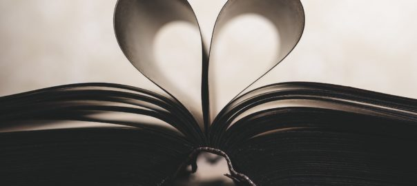Open book with pages folded into a heart - love songs you've never heard of