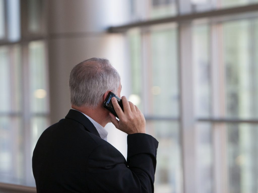 An agent on the phone with his client